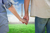 Composite image of couple holding hands in park