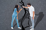 Composite image of angry couple shouting at each other