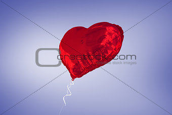 A large red heart balloon