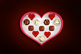 Composite image of heart shaped box of candy