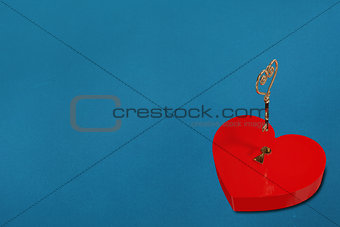 Bright red heart shaped lock with key
