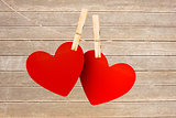 A pair of hearts pegged on a line