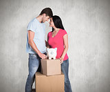Composite image of young couple with moving boxes