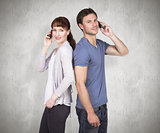 Composite image of couple both making phone calls