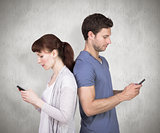 Composite image of couple both sending text messages