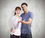 Composite image of couple holding out their hands