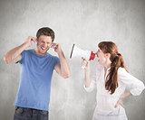 Composite image of woman shouting through a megaphone