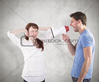 Composite image of man shouting through a megaphone