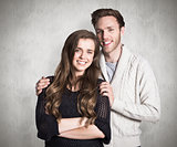 Composite image of portrait of smiling young couple