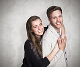 Composite image of portrait of happy young couple