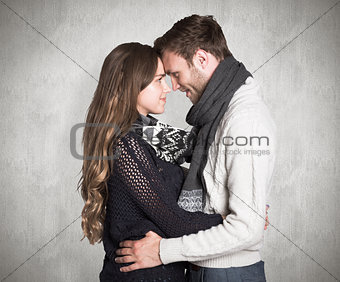 Composite image of side view of young couple embracing