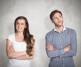 Composite image of smiling young couple with arms crossed