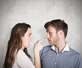 Composite image of casual young couple in an argument