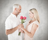 Composite image of affectionate man offering his partner roses