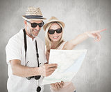 Composite image of happy tourist couple using map and pointing