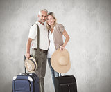 Composite image of happy couple ready to go on holiday