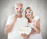 Composite image of happy couple wearing 3d glasses eating popcorn