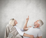 Composite image of smiling couple lying and looking up