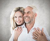Composite image of smiling couple embracing with woman looking at camera
