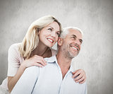 Composite image of smiling couple embracing and looking