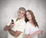 Composite image of casual couples on their phones