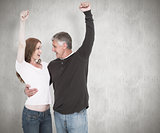 Composite image of casual couple cheering and smiling