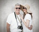 Composite image of vacationing couple