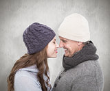 Composite image of couple in warm clothing facing each other