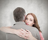 Composite image of casual couple hugging each other