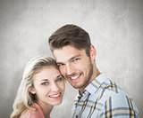Composite image of attractive couple smiling at camera