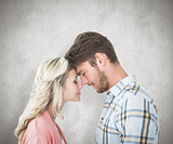 Composite image of attractive couple standing touching heads