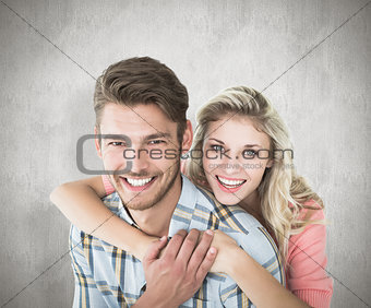 Composite image of attractive couple embracing and smiling at camera