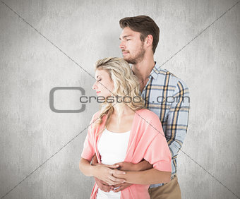 Composite image of attractive young couple embracing and smiling