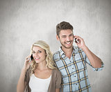 Composite image of attractive couple talking on their smartphones