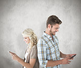 Composite image of attractive couple using their smartphones