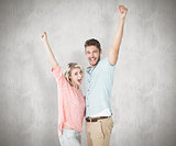 Composite image of attractive couple smiling and cheering