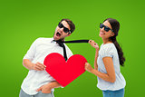 Composite image of brunette pulling her boyfriend by the tie holding heart