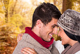 Composite image of young couple smiling and hugging