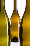 Detail of three empty wine bottles