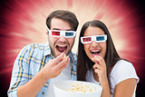 Composite image of attractive young couple watching a 3d movie