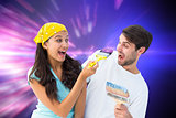 Composite image of happy young couple painting together and laughing