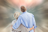 Composite image of mature couple hugging and looking