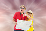 Composite image of happy tourist couple using map