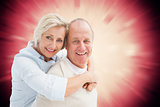 Composite image of happy mature couple smiling at camera