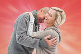 Composite image of happy mature couple in winter clothes