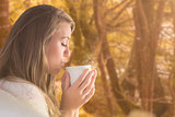 Composite image of pretty blonde relaxing on the couch with tea