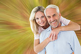 Composite image of smiling couple embracing and looking at camera