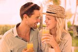 Hip young couple drinking orange juice together