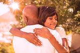 Happy couple hugging each other in garden