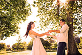 Loving young couple holding hands at park